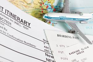Travel theme with ticket itinerary baggage claim and boarding pass