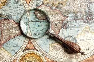 Magnifying glass and ancient old map
