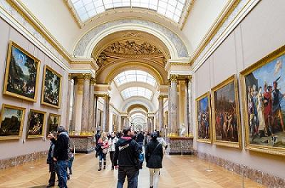 PARIS - APRIL 07: Tourists walk in Museum Louvre on April 07, 2013 in Paris, France